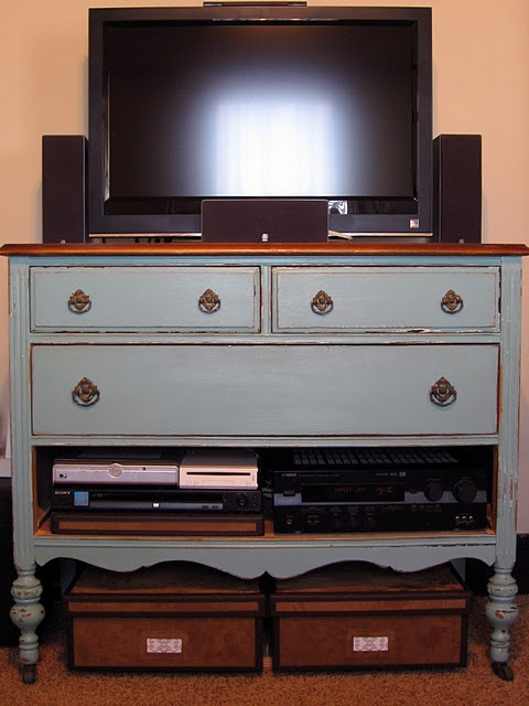 My cable box and dvd player sit next to my tv right now and it drives me crazy! What a great idea take out a drawer and put them in the dresser!