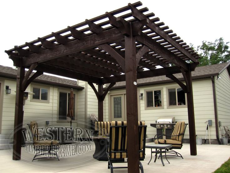 Free standing ShadeScape™ solid wood pergola kit, dovetailed oversize timbers with Rich Cordoba stain and Crescent style beam and rafter end profiles.