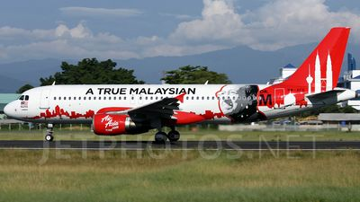 AirAsia (MY) Airbus A320-214 9M-AFO aircraft, painted in ''painted in ''A True Malaysian Mr M'' special colours Oct. 2011 - Nov. 2015, skating at Malaysia Kota Kinabalu  International Airport. 20/08/2012. (Mr M-A True Malaysian=Mahathir bin Mohamad=a Malaysian politician, the fourth Prime Minister of Malaysia from 1981-2003).