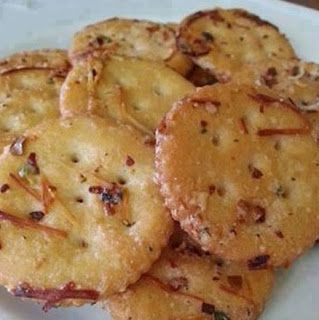 1 stick melted butter,  1 packet Ranch dressing mix, ¼ c. grated Parmesan,  1 tbsp. red pepper flakes 1 tsp. garlic powder.  1 box Ritz crackers How to make it : toss box of Ritz crackers with all 5 ingredients Bake in 300 degree oven for 15 minutes