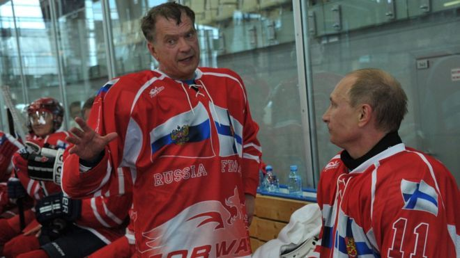 Russia's President Vladimir Putin (R) and Finland's President Sauli Niinisto (C) speak as they take part in a friendly ice hockey match in Igora resort near in St. Petersburg, on June 22, 2012.