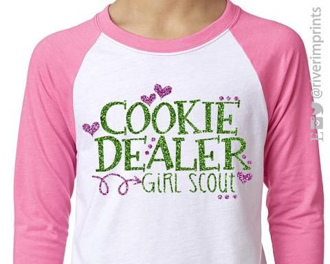 Show your COOKIE DEALIN' Girl Scout Pride in this White and Pink raglan with green and pink glitter design!
