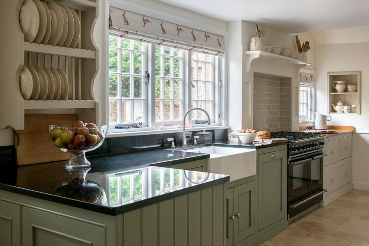 Pepperbox trading, blinds from Peony & Sage. Would be good with a dark blue Aga rather than a modern range.