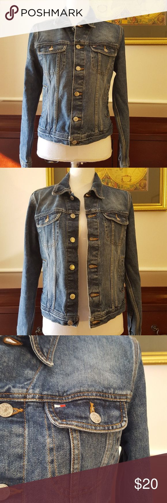 """Tommy Hilfiger Trucker Logo Jean Jacket Medium Nice Vintage look denim jacket with Hilfiger logos. Button Front. Button pockets at chest with slant pockets at waist. Hilfiger flag logo on chest. Leather patch at side hip. 100% Cotton. Very good used condition. Approximate Measurements: Chest 19.5"""" Across  Shoulder to Shoulder 16.5"""" Across  Length 21"""" Tommy Hilfiger Jackets & Coats Jean Jackets"""