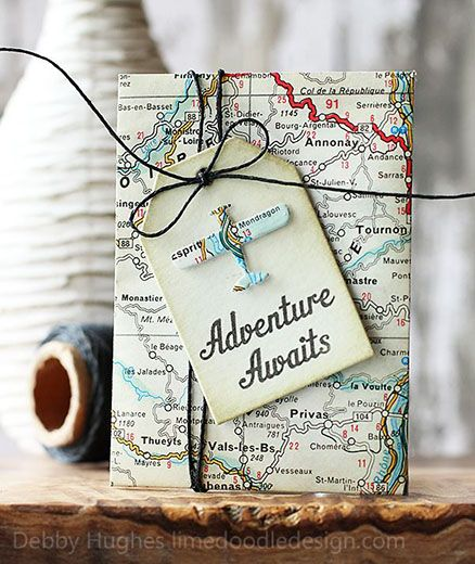 """Joli papier cadeau fait à partir de vieille carte routière. """"Adventure awaits!""""."""