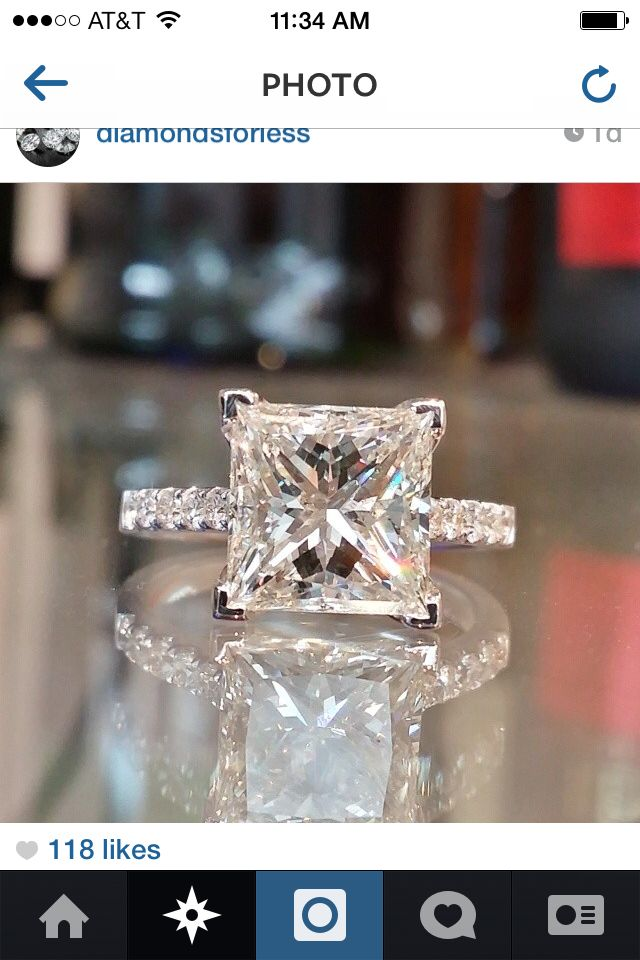 Princess Cut diamond with round cut diamonds. Love the prongs! Favorite engagement ring ever!!!!! Do not need or want an eternity band. Substitute Amora Moissanite for the diamond, as it's less expensive and a more unique stone, and I don't have to worry about the international logistics of diamond production (ie blood diamonds in Africa.) FOUND MY RING!