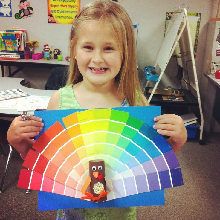 I like this idea for a color wheel for little ones.  But maybe peacocks and they could paint or use painted scrapes that they cut into feather shapes?  Flat peacock body.  Culmination to first grade color projects?