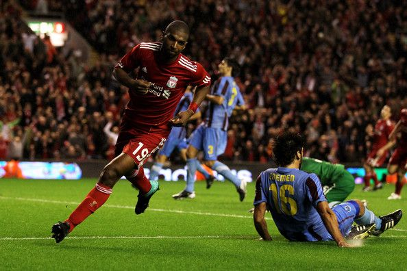 Ryan Babel of Liverpool celebrates after he scores the first goal of the game during the UEFA Europa League play-off first leg match beteween Liverpool and Trabzonspor at Anfield on August 19, 2010 in Liverpool, England. - 14 of 46