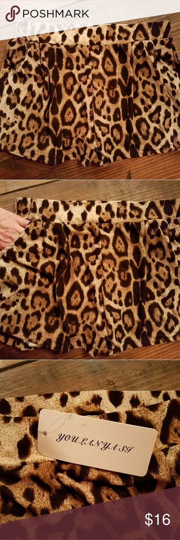 Sexy silky leopard shorts Sexy silky leopard shorts. Fabric is 65% cotton 35% polyester but they feel very satiny and silky. They are size large but fit like a small or x-small. Two front pockets. Give 'em a try! YOULANYAST Shorts