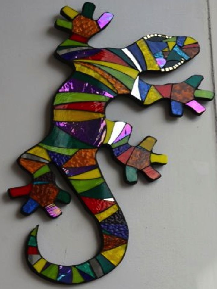 This is an old wooden window frame with stained glass butterfly design applied in the mosaic fashion. Description from pinterest.com. I searched for this on bing.com/images