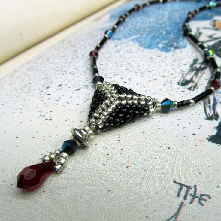 Black Beaded Necklace Silver & Red Crystal, Seed Bead Jewelry by MRSBAUBLES on Etsy https://www.etsy.com/listing/37386255/black-beaded-necklace-silver-red-crystal