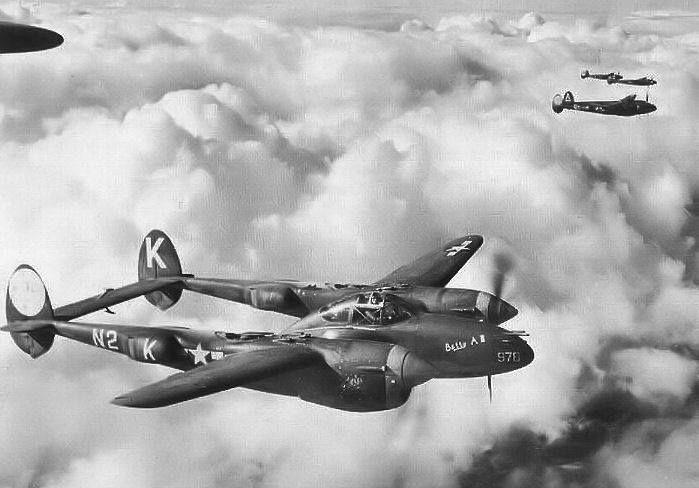 P-38J Lightning aircraft in flight England 1944.
