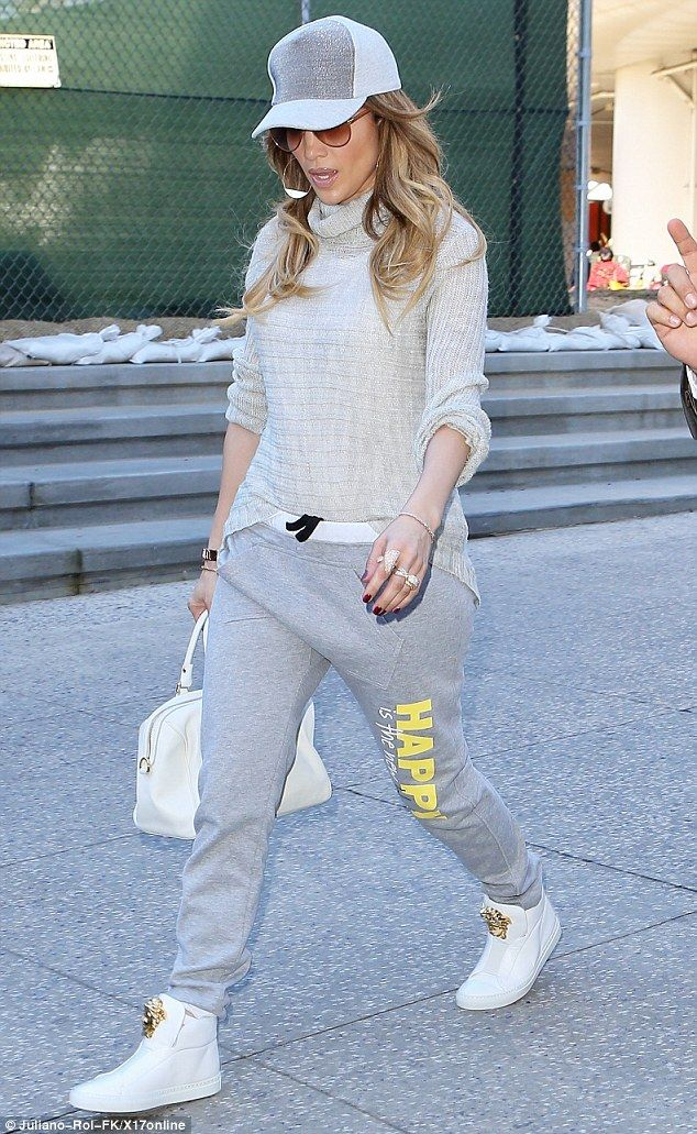 Always stylish: Though J-Lo was dressed comfortably for the flight, she did not miss an opportunity to wear designer items. On her feet were a pair of white Versace high tops and she carried with her a matching purse