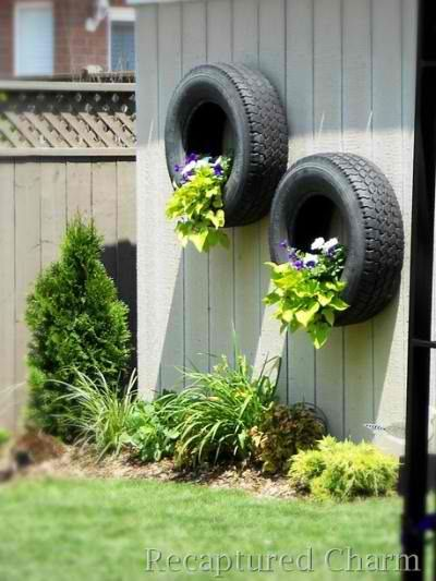 Tire Wall Planter | 12 Fence Planters That'll Have You Enjoying Your Private Garden