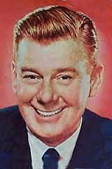 Arthur Godfrey (August 31, 1903 – March 16, 1983). Born in New York, NY. At the age of 15 he lied about his age and enlisted in the US Navy serving on a destroyer from 1920-24. Later he joined the US Coast Guard serving from 1927-30. Radio and television broadcaster and entertainer best known for his television series Arthur Godfrey and His Friends.