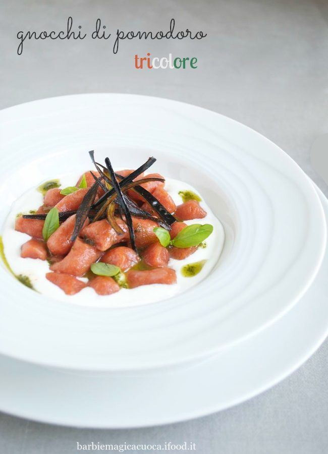 gnocchi di pomodoro tricolore su crema di burrata con emulsione al basilico e chips di bucce di melanzana