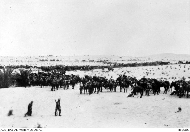 Bir el Nuss, Sinai. August 1916. Men and horses of the 3rd Australian Light Horse Brigade preparing for an attack at Katia in the Romani area on 5 August 1916. (Donor Mrs L.E. McAllister)