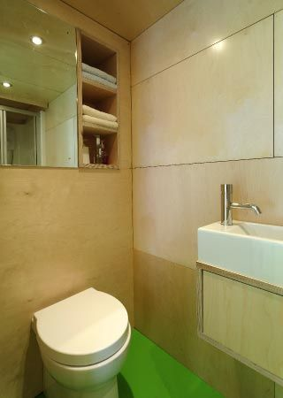 Bright vinyl floor. Like the plywood storage under the basin. Like the recessed …   – most beautiful shelves
