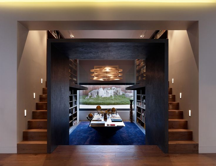 House in La Moraleja by Dahl Architects   GHG Architects - two story home library!