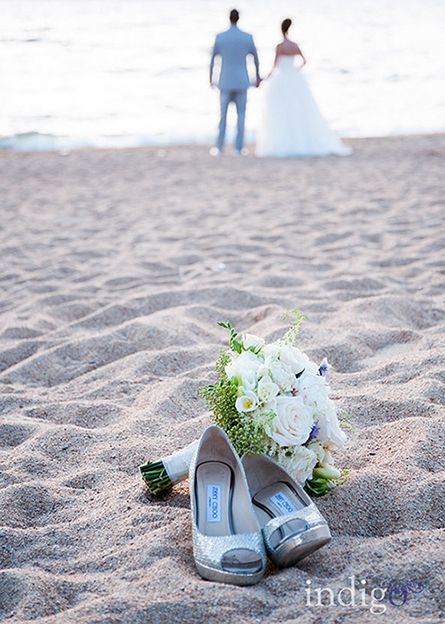 Location: shoreline in front of The Landing Resort and Spa, a five-star resort with comprehensive services. Lighting: soft summer twilight. Memory: barefoot in the sand, kicking back and looking forward to married life. Photo: Indigo Photography by Brandi. #beachwedding www.TahoeWeddingSites.com