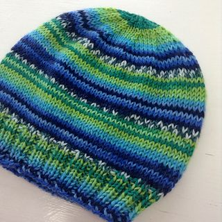 This pattern was written for the Adriafil Knitcol self-striping yarn, but I also included several different yarn weights and gauge options on the second page. If you knit the XS, you'll have enough yarn left over to make a pom pom for your hat.: