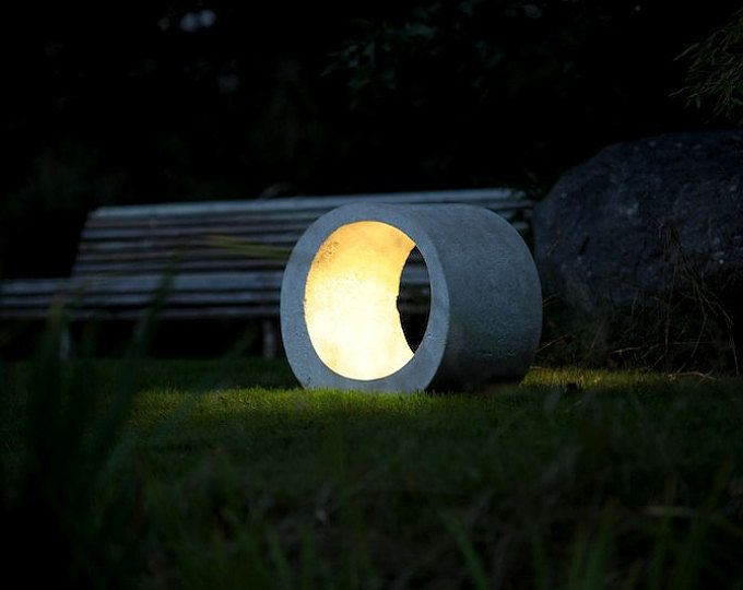 Concrete table lamp. 1 LED, 1,5watt, IP65 rated = waterproof, warm white  Dimensions: 31 cm L x 15 cm H x 9.5 cm W, 3,7kg Choice of colors - contact me.  Each lamp is a hand made piece and each is slightly different.  Light strength controlled by soft touch dimmer. Transformer works with US and European current (110 - 220V) with plug type for your region. If unavailable, simple adapters work fine.
