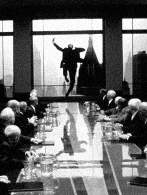 The Great Depression. This picture shows a man is jumping out of the window while the meeting is going on. This picture represents the great depression because people could not find a solution to slow down the depression, and people did not have the money to live in the bad economy.