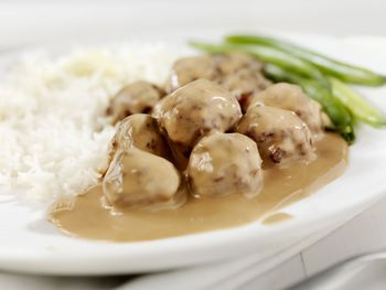 Learn how to make easy slow cooker Swedish meatballs using frozen meatballs and prepared gravy. Add sour cream or heavy cream to the finished gravy.