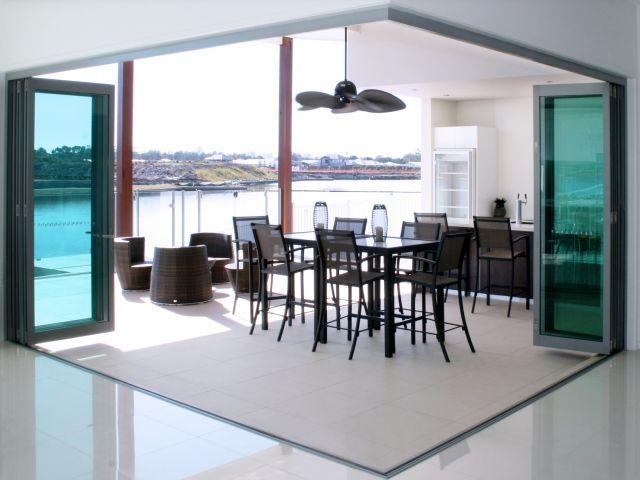 Alfresco living with stacker and bifold doors by Trend Windows & Doors Pty Ltd – Selector