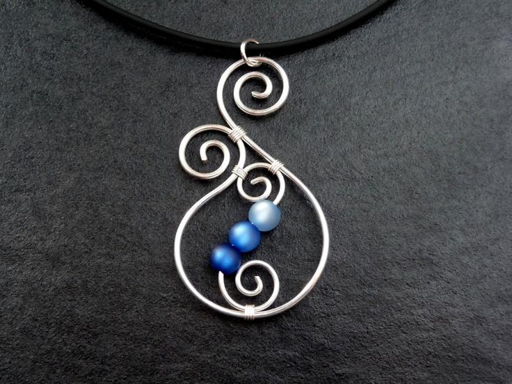 Necklace - Aotearoa - with Polarisbeads BLUE New Zealand Koru wire wrapped. €11,00, via Etsy.