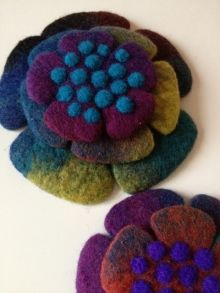 Brooch? I love the colors!! I'd wear it as a brooch. Or two or three of them!
