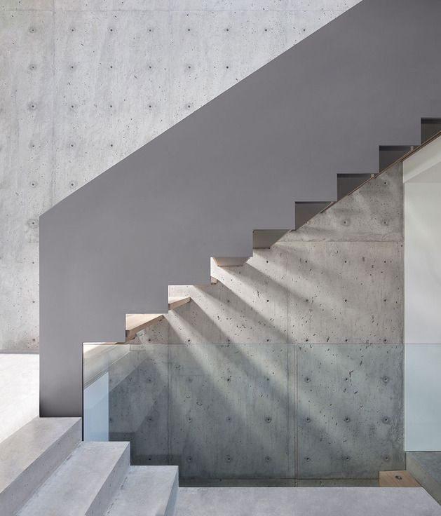 sleek-slope-house-with-interior-featuring-concrete-12-stairs-side.jpg