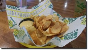 Quaker stake lube chips and dip, an easy and delicious recipe you can make yourself at home. It's worth a shot and recipe is on http://www.food.com/recipe/quaker-steak-and-lubes-beer-cheese-dip-511991 and then just make homemade baked potato chips to dip into the sauce.