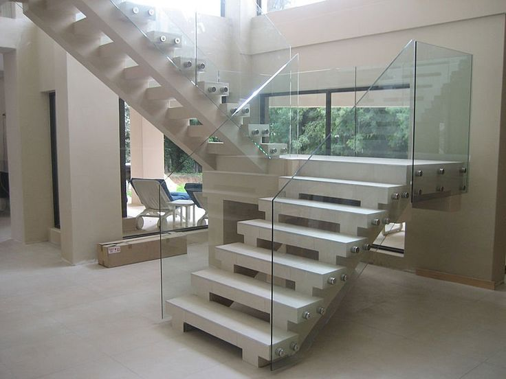 Frameless glass railing bolted into solid stairs modern for Interior glass railing designs