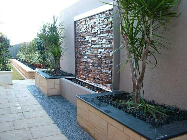 water feature and landscaping along fence backyard ideas