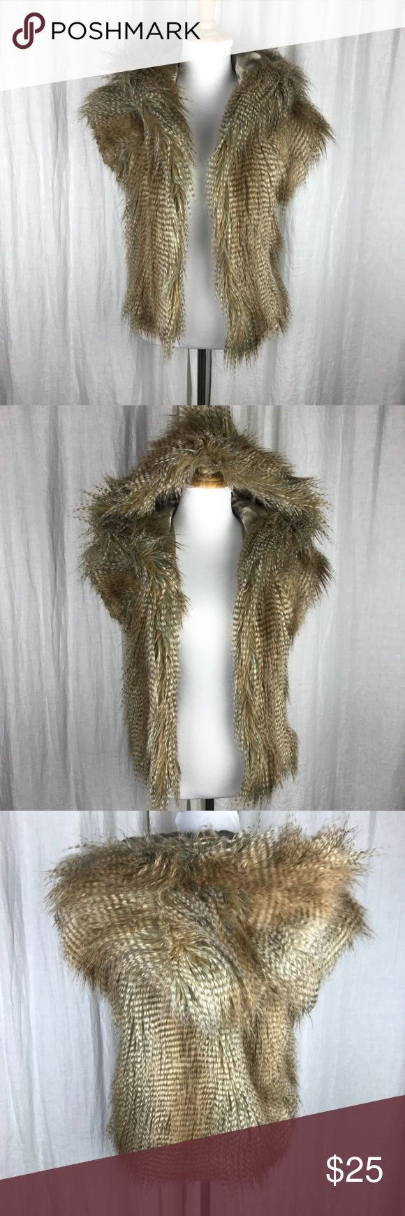 BCBGeneration Faux Fur Vest BCBGeneration Faux Fur Vest. Super cute and on trend! Hooded vest with pockets! Excellent condition and great for winter! BCBGeneration Jackets & Coats Vests