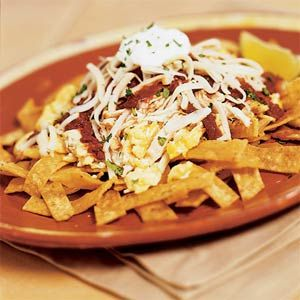 Chilaquiles are a Mexican dish usually eaten for breakfast. Look for dried ancho chilies in Latino markets. For a milder sauce, omit the jalapeño chili.