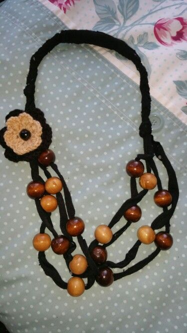 Brown and black beads with crochet flower