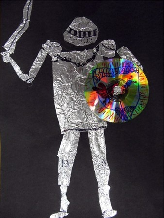 Knight of tin foil with CD shield- reusing, radial symmetry, alternative processes, collage, found art