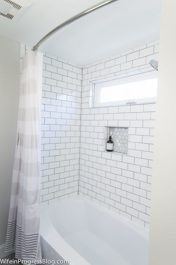 Farmhouse style bathroom with subway tile and gray accents