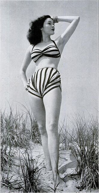 An instantly eye-catching striped halter bikini swimsuit from 1945. Vintage fashion beach resort sportswear 40s stripes