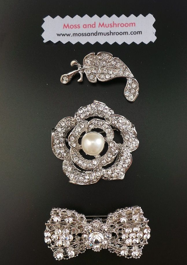 An eclectic collection of brooches, each measuring approx. 1in/2.5cm to 2.5in/6cm wide.  Perfect as a standalone accessory, in a bridal brooch bouquet, or as a beautiful accent to a bridemaid posy or corsage.Brooches in this collection start from just €4.00 + P&P