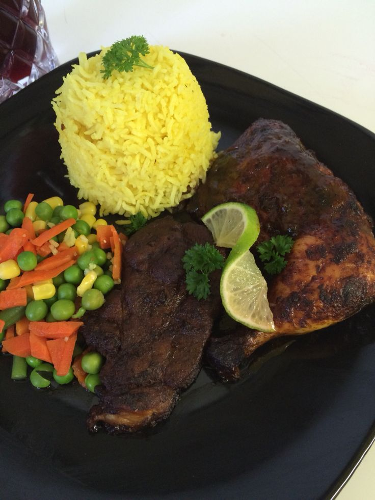 Jamaican home cooking ...Yellow rice with pan fried Pork  and baked Chicken