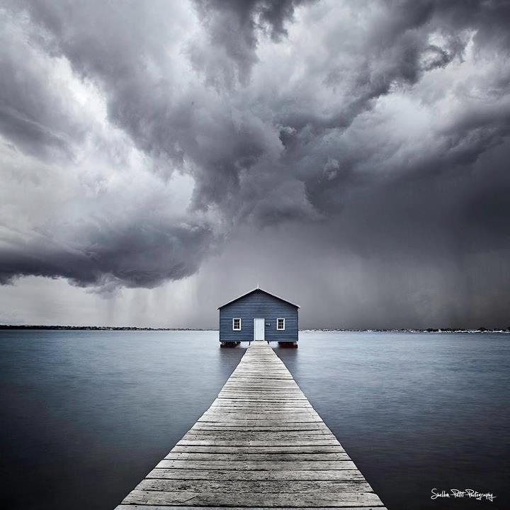 Swan River Blue Boat House. You will see it when driving on Mounts Bay Road. Popular spot for wedding photoshoots in Perth.