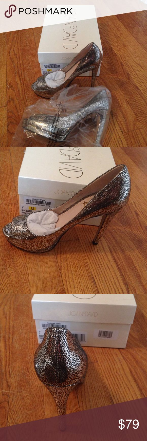 Brand New Joan & David silver heels Brand new in box Joan & David silver high heels size 7. Joan & David Shoes Heels