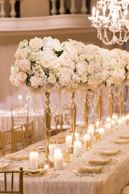We are amazed at these elegant and romantic centerpieces by Bella Floral of Dallas! Captured by Ben Q. Photography #bridesofnorthtx #weddings #centerpieces