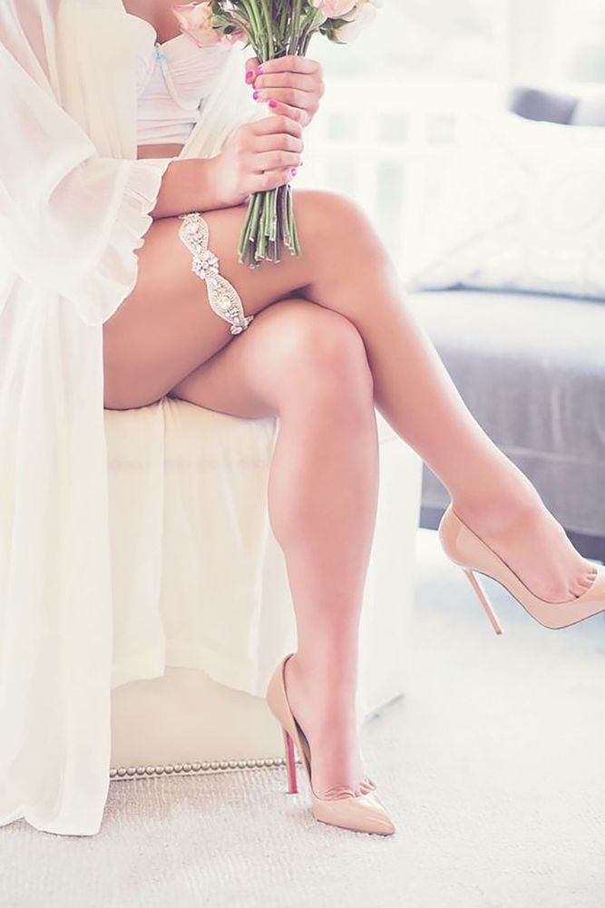 sexy wedding picture tempting leg with gorgeous garter