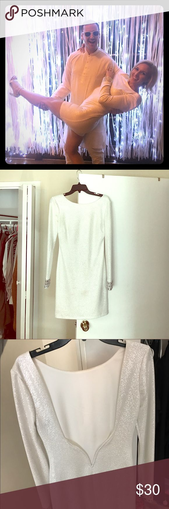 Holiday party White bodycon dress Macy's long sleeved, mid thigh length, white bodycon dress, silver gem cuffs, backless dress that is sexy but still classy. Worn once for an all white themed New Years party, received many compliments. Dry cleaned after worn. I am 5'9, 145 lbs and it fit perfect Macy's Dresses Midi