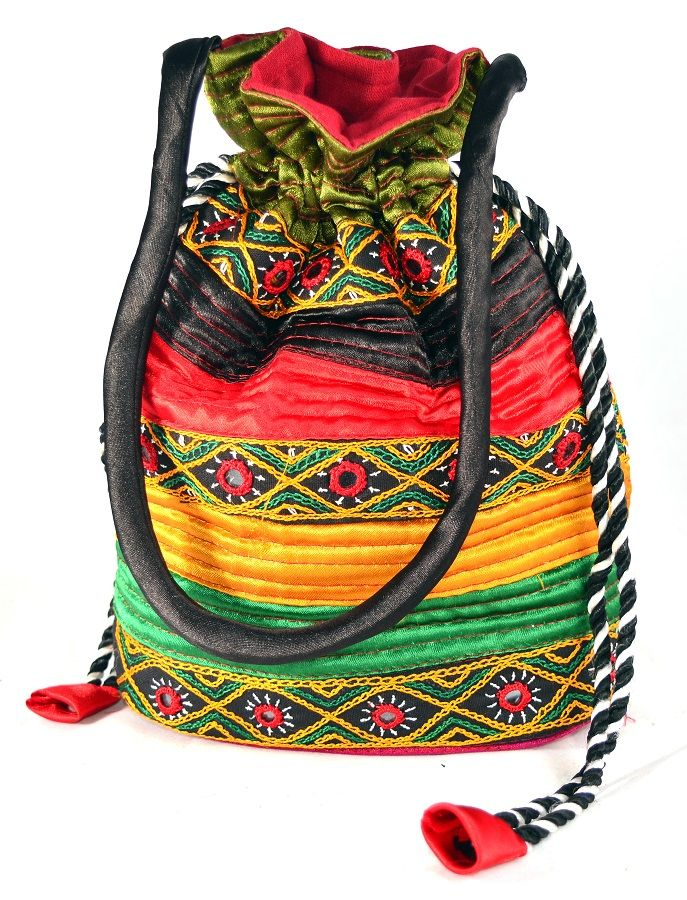 Traditional potli made of silk with stylish design in compact size to carry anywhere and keep things inside safely.Handicraft work done with high quality using excellent color combination.This beautiful  Handmade Potli Bag is adorned with traditional ahir work and is in rich .A potli bag repres  #Buyhandbagsonline #HandmadeHandbags #Authenticdesignerhandbags #Womenswallets #Pursesonline #Handmadeitems #Styleincraft