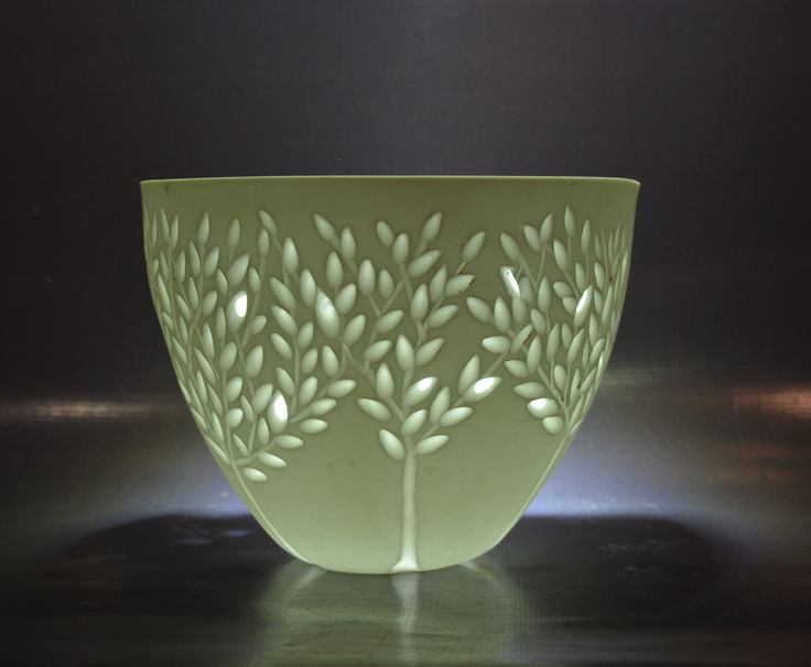 Carved Bone China Bowl - Rika Herbst  grains of rice/grain pressed into the wet clay created the thin spots and light shines through